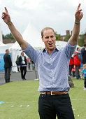 Prince William Duke of Cambridge plays a game during a visit to the Commonwealth Games Village on July 29 2014 in Glasgow Scotland