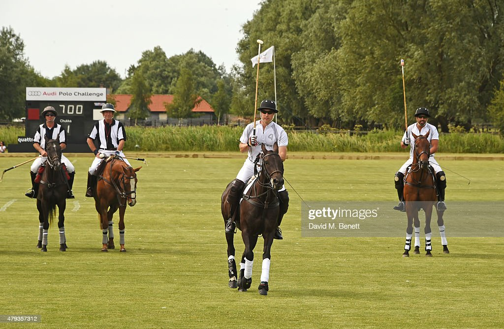 Prince William, Duke of Cambridge, (C) plays during the Audi Polo Challenge 2015 at Cambridge County Polo Club on July 3, 2015 in Cambridge, England.