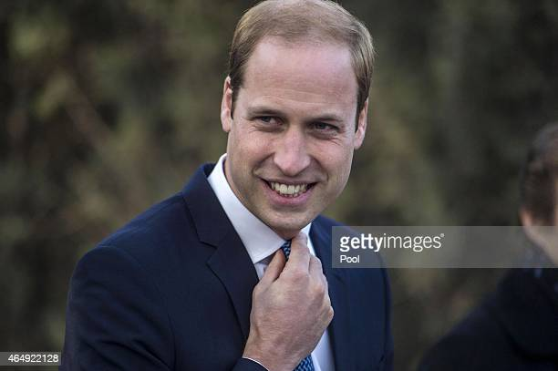 Prince William Duke of Cambridge poses after painting the eye of 'shaun the sheep' at the British Ambassador's official residence on March 2 2015 in...