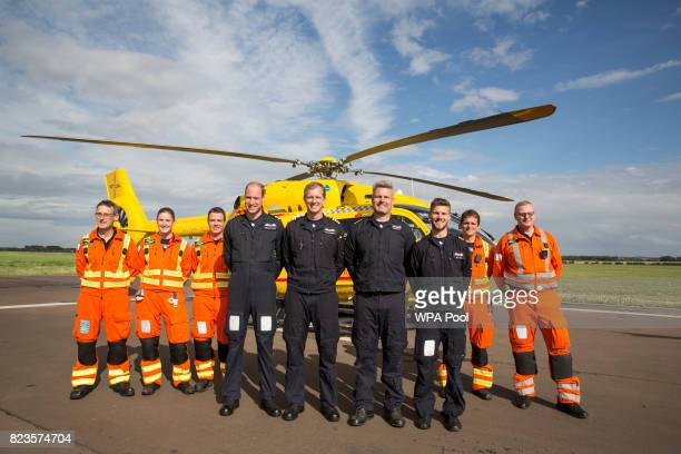 Prince William Duke of Cambridge poses for a final photo with both day and night shift crews CCP Gary Spitzer Dr Karen rhodes Dr Adam Chesters Cpt...