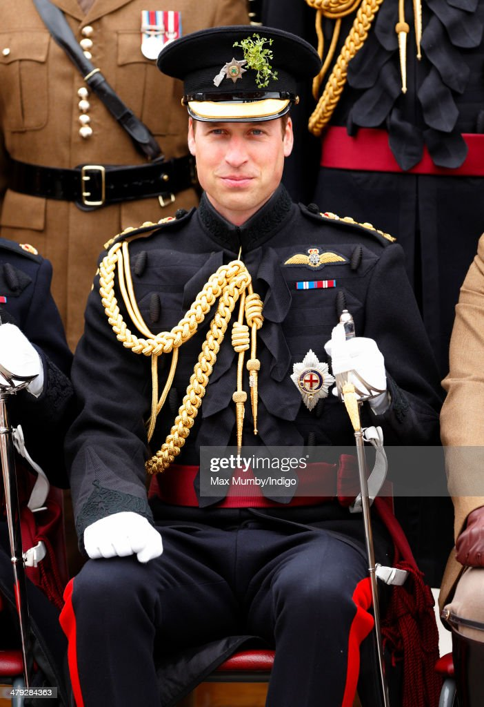 Prince William, Duke of Cambridge poses for a group photograph with soldiers of the Irish Guards as he attends the St Patrick's Day Parade at Mons Barracks on March 17, 2014 in Aldershot, England. Catherine, Duchess of Cambridge and Prince William, Duke of Cambridge visited the 1st Battalion Irish Guards to present the traditional sprigs of Shamrocks to the Officers and Guardsmen of the Regiment.
