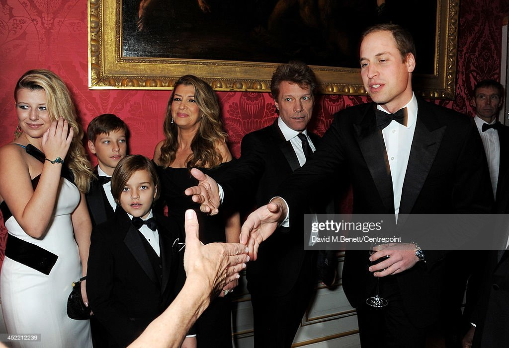 Prince William, Duke of Cambridge (R), poses with Jon Bon Jovi (2R), wife Dorothea Hurley and children Stephanie Rose, Jesse, Jacob and Romeo at the Winter Whites Gala in aid of Centrepoint at Kensington Palace on November 26, 2013 in London, England.