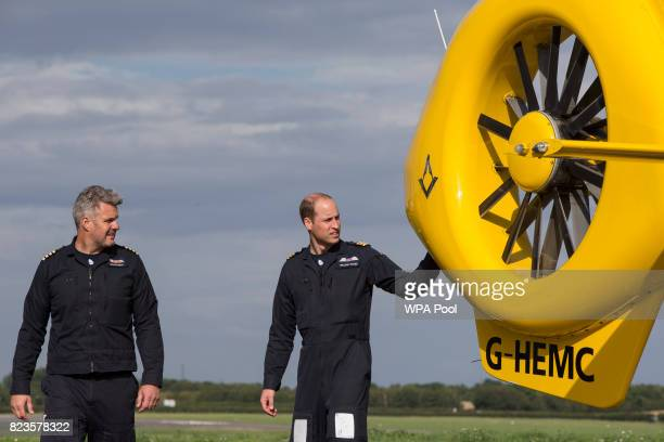 Prince William Duke of Cambridge prepares for his final shift with Cpt Dave Kelly of the East Anglian Air Ambulance based out of Marshall Airport on...