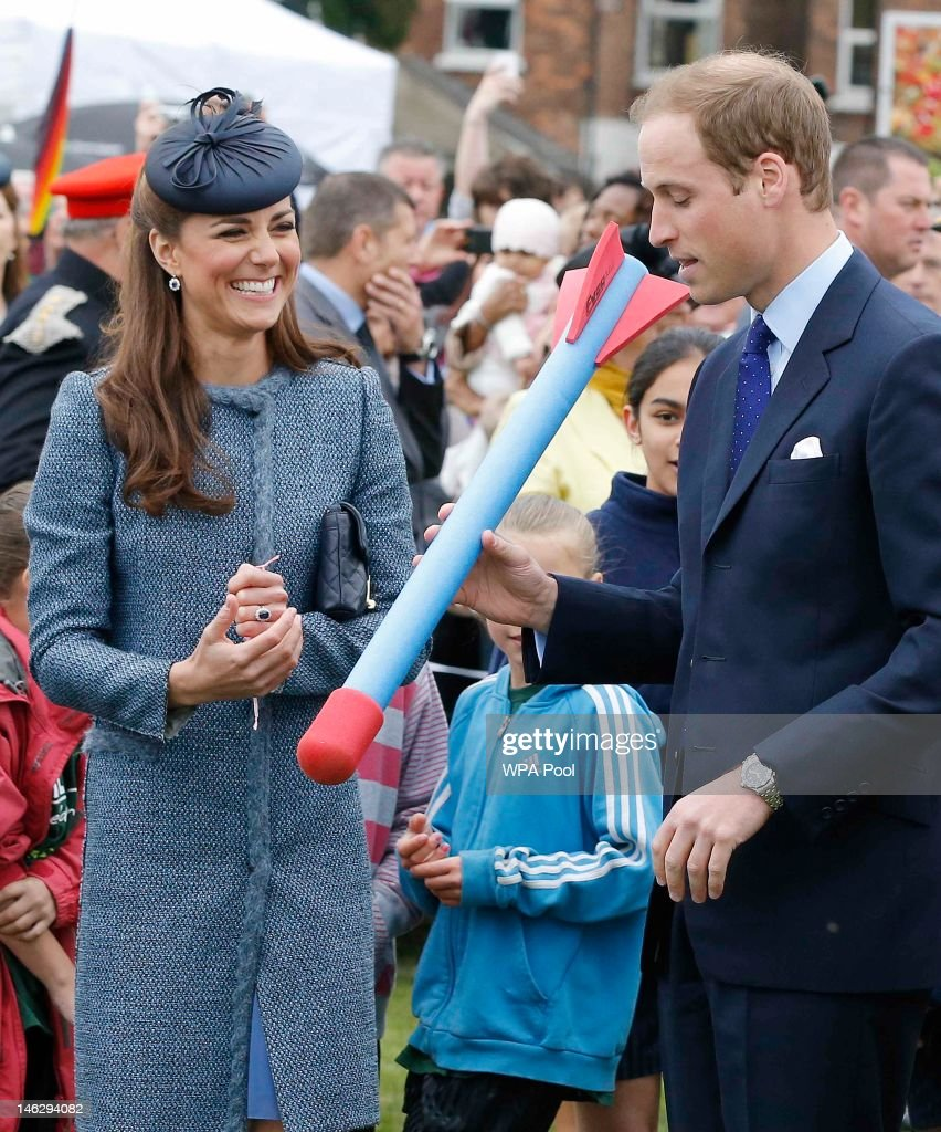 <a gi-track='captionPersonalityLinkClicked' href=/galleries/search?phrase=Prince+William&family=editorial&specificpeople=178205 ng-click='$event.stopPropagation()'>Prince William</a>, Duke of Cambridge preparesto throw a foam javelin as part of a children's sports event as his wife <a gi-track='captionPersonalityLinkClicked' href=/galleries/search?phrase=Catherine+-+Duchess+of+Cambridge&family=editorial&specificpeople=542588 ng-click='$event.stopPropagation()'>Catherine</a>, Duchess of Cambridge looks on while visiting Vernon Park during a Diamond Jubilee visit to Nottingham on June 13, 2012 in Nottingham, England.
