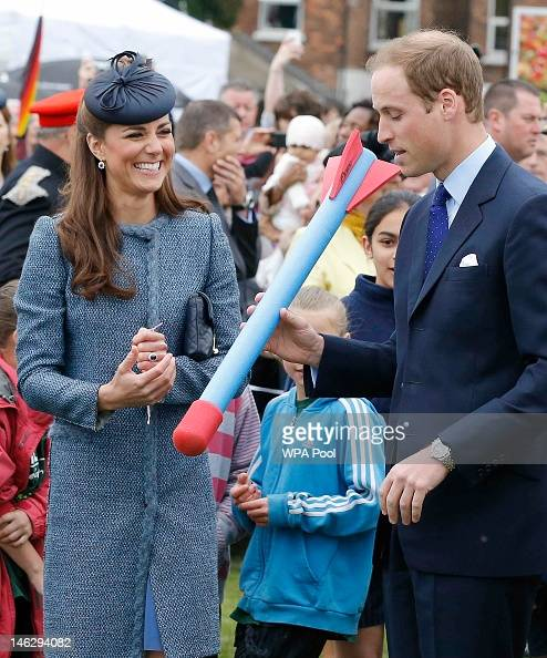 Prince William Duke of Cambridge preparesto throw a foam javelin as part of a children's sports event as his wife Catherine Duchess of Cambridge...