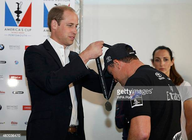 Prince William Duke of Cambridge presents a medal to skipper Glenn Ashby of Emirates Team New Zealand placed second at the close of the British leg...
