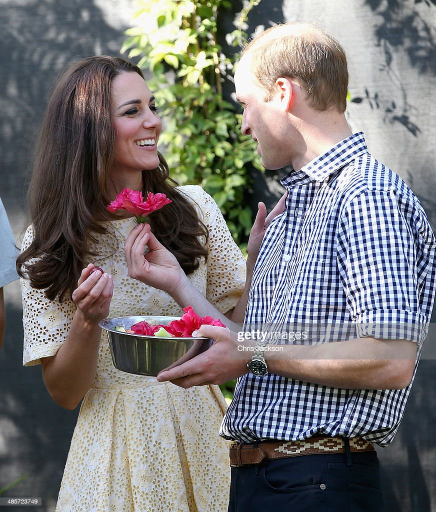 Prince William, Duke of Cambridge presents Catherine, Duchess of Cambridge with a flower in the tree kangaroo enclosure at Taronga Zoo on April 20, 2014 in Sydney, Australia. The Duke and Duchess of Cambridge are on a three-week tour of Australia and New Zealand, the first official trip overseas with their son, Prince George of Cambridge.