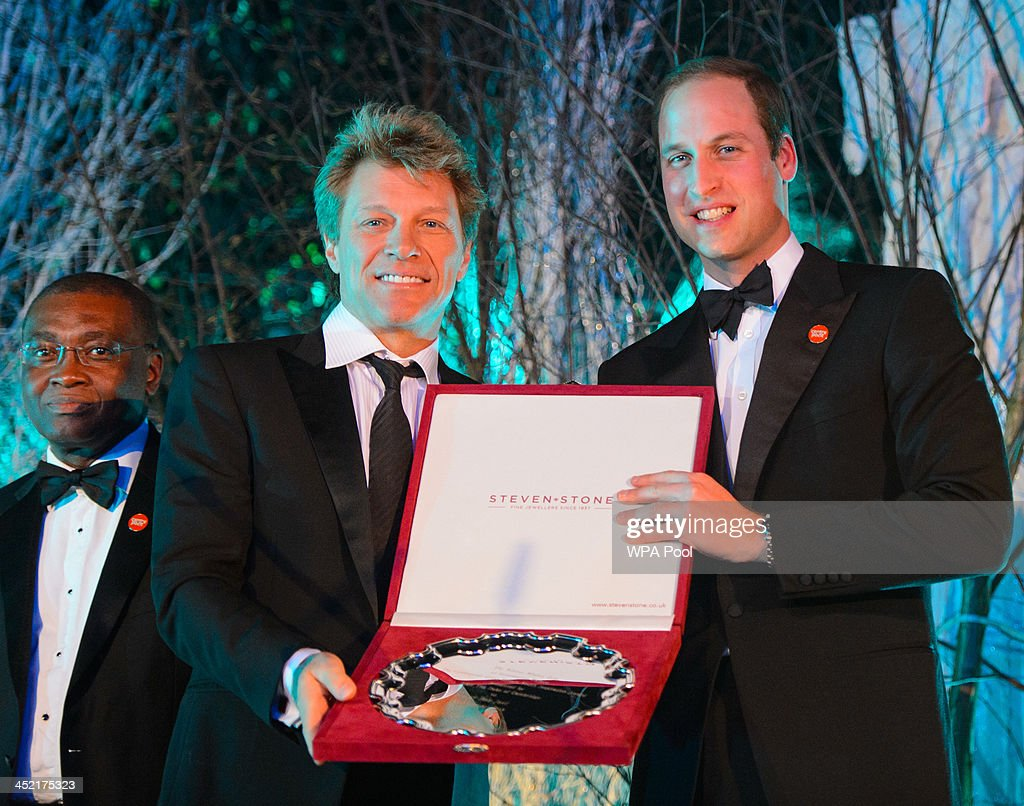 Prince William, Duke of Cambridge (R) presents Jon Bon Jovi with the Centrepoint Great Britain Youth Inspiration Award at the Centrepoint Gala Dinner at Kensington Palace on November 26, 2013 in London, England.