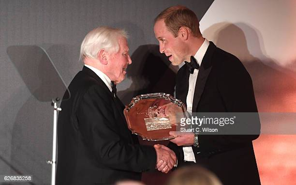 Prince William Duke of Cambridge presents Sir David Attenborough an award for his services to wildlife during the Tusk Trust Awards at Victoria...
