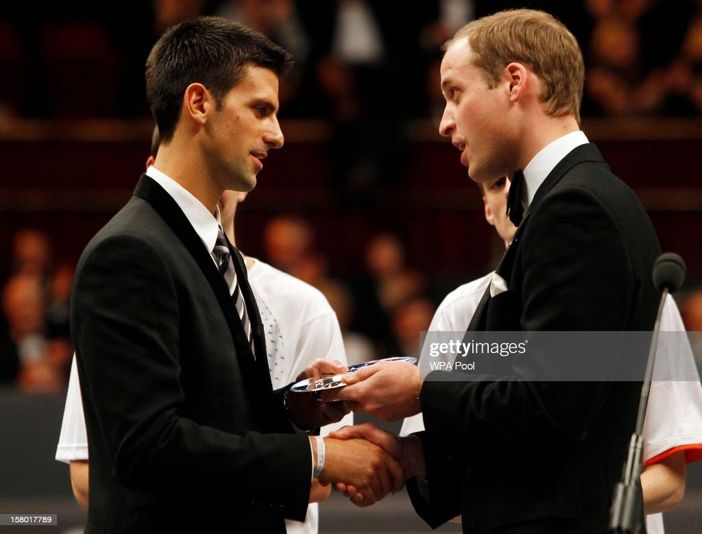 Prince William, Duke of Cambridge presents tennis player <a gi-track='captionPersonalityLinkClicked' href=/galleries/search?phrase=Novak+Djokovic&family=editorial&specificpeople=588315 ng-click='$event.stopPropagation()'>Novak Djokovic</a> with the 'Centrepoint Premier Award for Contribution to the Lives of Youth Accross the World' in recognition of his Novak Djokavic Foundation at the Winter Whites Gala, in aid of the homeless charity Centrepoint, at the Royal Hall on December 8, 2012 in London, England.