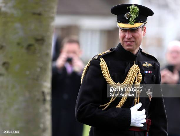 Prince William Duke Of Cambridge presents the 1st Battalion Irish Guardsmen with shamrocks during the annual Irish Guards St Patrick's Day Parade at...