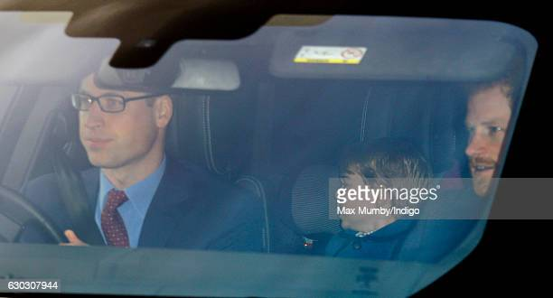 Prince William Duke of Cambridge Prince George of Cambridge and Prince Harry attend a Christmas lunch for members of the Royal Family hosted by Queen...