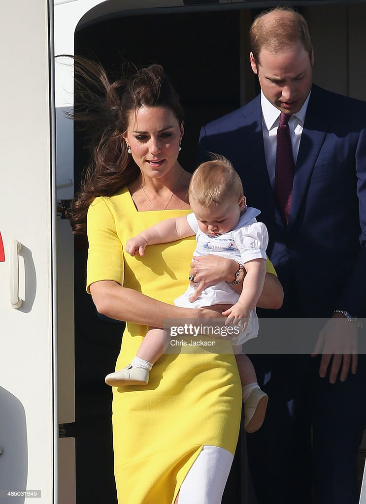 Prince William, Duke of Cambridge, Prince George of Cambridge and Catherine, Duchess of Cambridge arrive at Sydney Airport on a Australian Airforce 737 aircraft on April 16, 2014 in Sydney, Australia. The Duke and Duchess of Cambridge are on a three-week tour of Australia and New Zealand, the first official trip overseas with their son, Prince George of Cambridge.