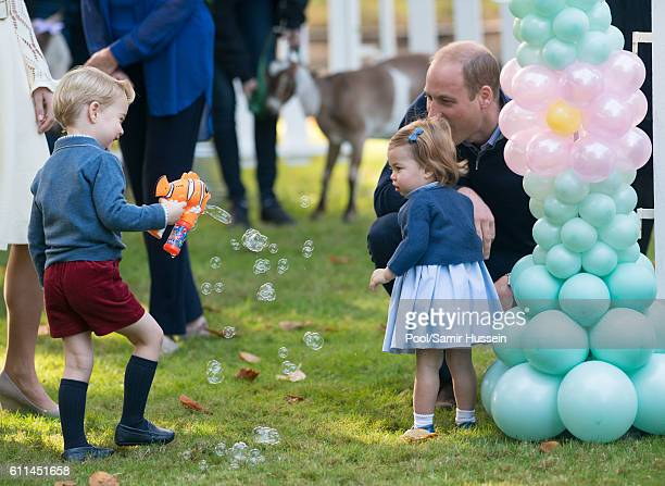 Prince William Duke of Cambridge Prince George of Cambridge and Princess Charlotte of Cambridge attend a children's party for Military families...