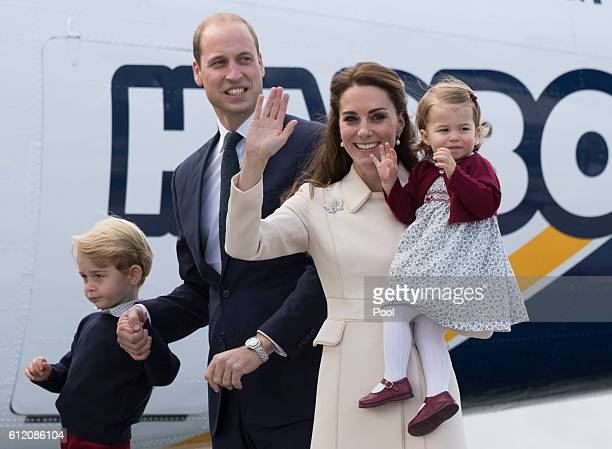 Prince William Duke of Cambridge Prince George of Cambridge Catherine Duchess of Cambridge and Princess Charlotte wave as they leave from Victoria...