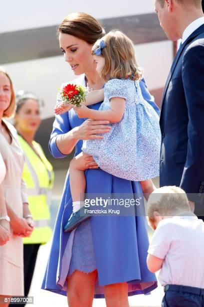 Prince William Duke of Cambridge Prince George of Cambridge Catherine Duchess of Cambridge and Princess Charlotte of Cambridge arrive at Berlin Tegel...