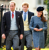 Prince William Duke of Cambridge Prince Harry and Catherine Duchess of Cambridge attend the wedding of Lucy Meade and Charlie Budgett at the church...