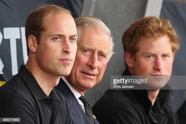 Prince William Duke of Cambridge Prince Harry and Prince Charles Prince of Wales watch the athletics at Lee Valley Track during the Invictus Games on...
