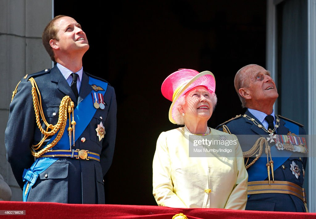 Prince William, Duke of Cambridge, Queen Elizabeth II and Prince Philip, Duke of Edinburgh watch a flypast of Spitfire & Hurricane aircraft from the balcony of Buckingham Palace to commemorate the 75th Anniversary of The Battle of Britain on July 10, 2015 in London, England.