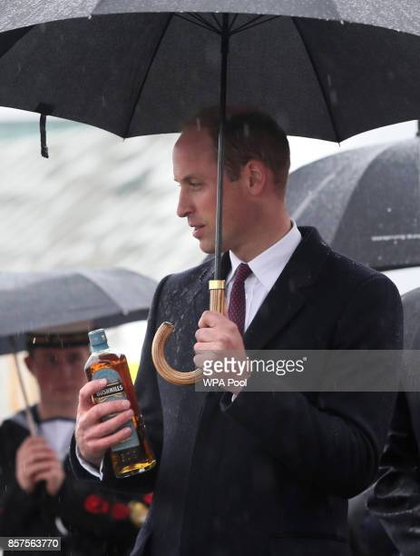 Prince William Duke of Cambridge receives a bottle of Bushmills Whisky as he names a life boat for Lagan Search and Rescue a rescue and lifeboat...