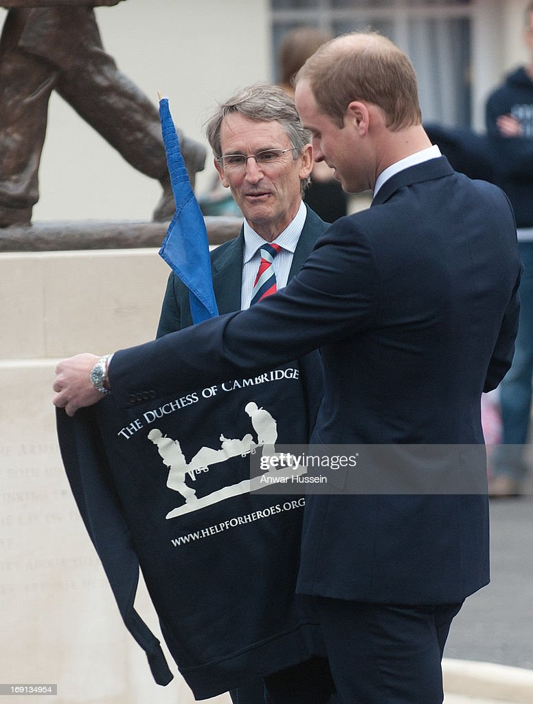 Prince William, Duke of Cambridge receives a 'Help For Heroes' sweatshirt as he visits Help For Heroes Recovery Centre on May 20, 2013 in Tidworth, England.