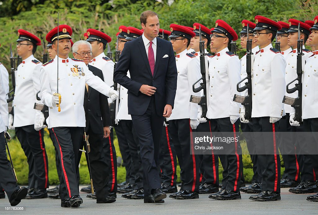 <a gi-track='captionPersonalityLinkClicked' href=/galleries/search?phrase=Prince+William&family=editorial&specificpeople=178205 ng-click='$event.stopPropagation()'>Prince William</a>, Duke of Cambridge reviews a Guard of Honour as he visits the Istana on day 1 of their Diamond Jubilee tour on September 11, 2012 in Singapore. <a gi-track='captionPersonalityLinkClicked' href=/galleries/search?phrase=Prince+William&family=editorial&specificpeople=178205 ng-click='$event.stopPropagation()'>Prince William</a>, Duke of Cambridge and Catherine, Duchess of Cambridge are on a Diamond Jubilee Tour of the Far East taking in Singapore, Malaysia, the Solomon Islands and the tiny Pacific Island of Tuvalu.