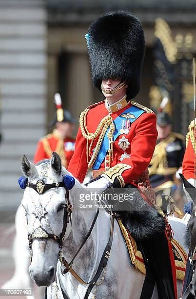 Prince William Duke of Cambridge rides by horse the annual Trooping the Colour Ceremony at Buckingham Palace on June 15 2013 in London England