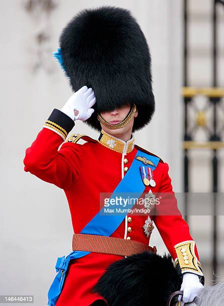 Prince William Duke of Cambridge salutes whilst riding on horseback during the annual Trooping the Colour Ceremony at Buckingham Palace on June 16...