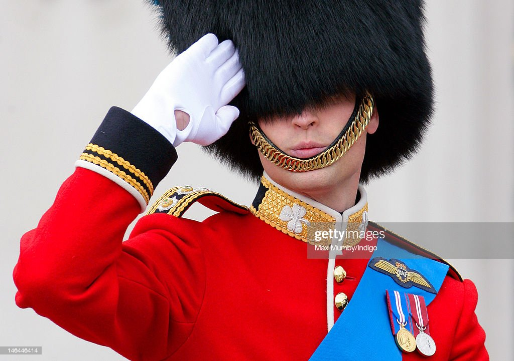 Prince William, Duke of Cambridge salutes whilst riding on horseback during the annual Trooping the Colour Ceremony at Buckingham Palace on June 16, 2012 in London, England.