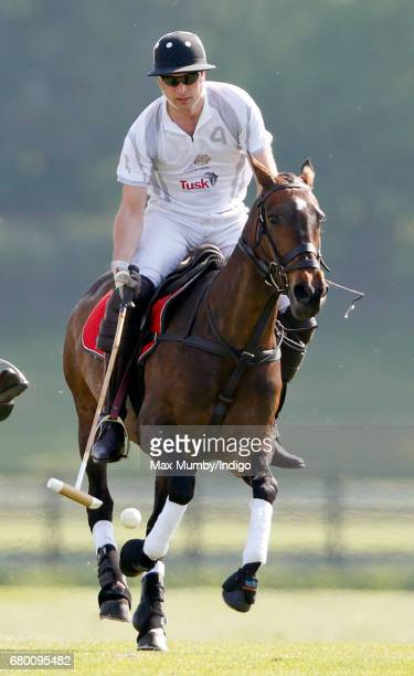 Prince William Duke of Cambridge scores a goal as he takes part in the Audi Polo Challenge at Coworth Park Polo Club on May 7 2017 in Ascot England