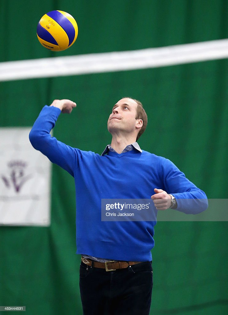 Prince William, Duke of Cambridge serves as he plays volleyball during a visit to a Coachcore project at Westway Sports Centre on December 4, 2013 in London, England.