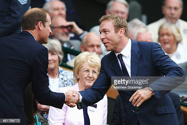 Prince William Duke of Cambridge shakes hands with Chris Hoy in the Royal Box on Centre Court before the Gentlemen's Singles Final match between...