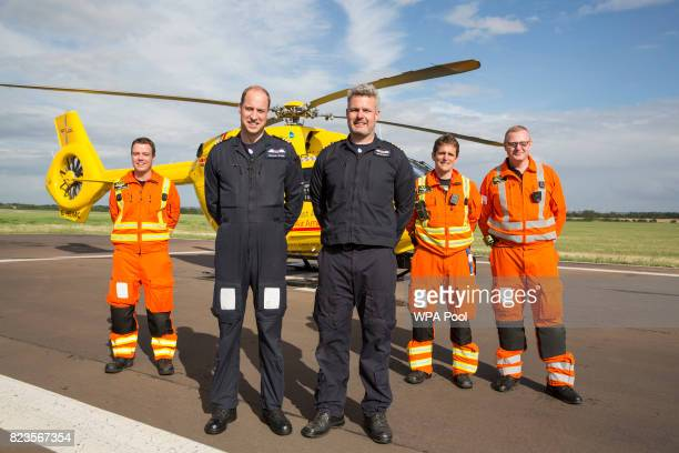 Prince William Duke of Cambridge smiles as he poses for a photo with colleagues Dr Adam Chesters Cpt Dave Kelly Dr Tobias Gouse and CCP Carl Smith...