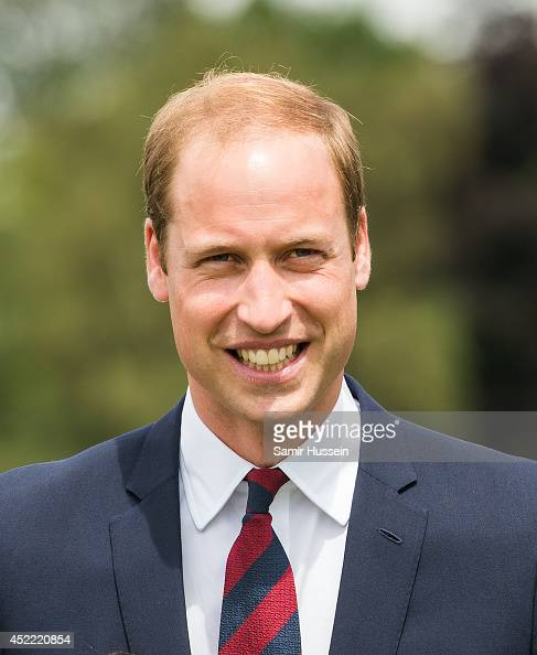 Prince William Duke of Cambridge smiles during an official visit to the Cambridge War Memorial Park on July 16 2014 in Coventry England The Duke made...