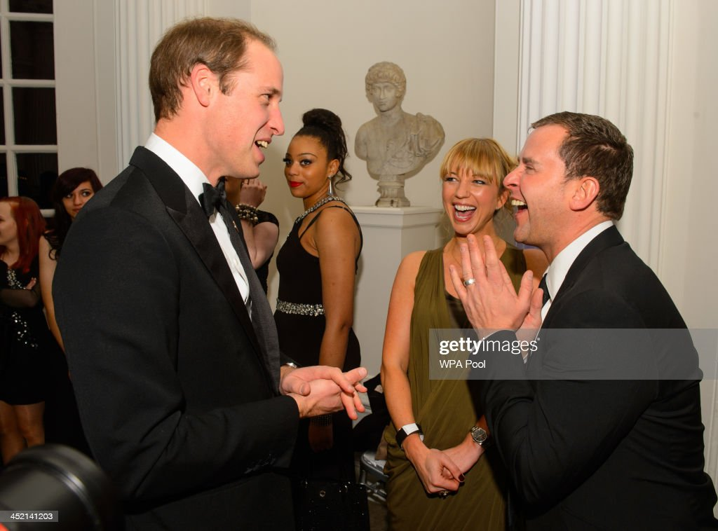 Prince William, Duke of Cambridge speaks to Centrepoint Ambassadors and BBC Radio DJs Sara Cox and Scott Mills at Kensington Palace for the Centrepoint Winter Whites Gala on November 26, 2013 in London, England.