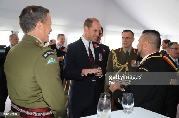 Prince William Duke of Cambridge speaks to guests as he attends a reception for the Battle of Passchendaele at Tyne Cot Cemetery on October 12 2017...
