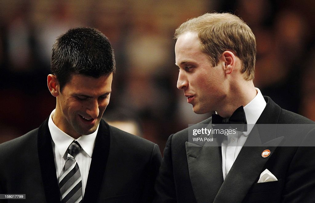 Prince William, Duke of Cambridge speaks to tennis player Novak Djokovic as he presents him with the 'Centrepoint Premier Award for Contribution to the Lives of Youth Accross the World' in recognition of his Novak Djokavic Foundation at the Winter Whites Gala, in aid of the homeless charity Centrepoint, at the Royal Hall on December 8, 2012 in London, England.