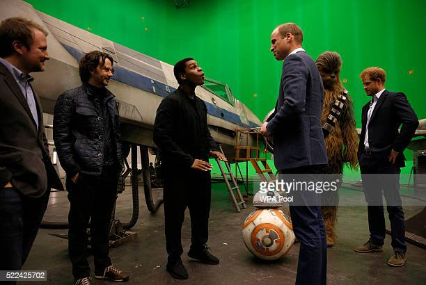 Prince William Duke of Cambridge speaks with British actor John Boyega and Episode VIII director Rian Johnson during a tour of the Star Wars sets at...
