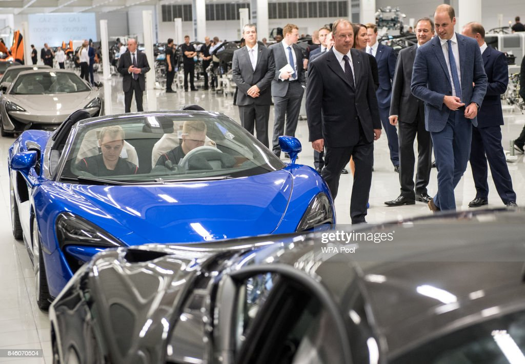 Prince William, Duke of Cambridge (C) speaks with employees on the McLaren commercial vehicle production line as he walks the factory floor during a visit to McLaren Automotive at McLaren Technology Centre on September 12, 2017 in Woking, England.