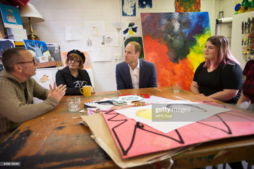 Prince William, Duke of Cambridge speaks with former clients Jason, Heather and Grace in the art room where clients can undergo a series of art lessons during a visit to the Spitalfields Crypt Trust in St Leonard's Church, Shoreditch on September 19, 2017 in London, England. The trust aims to provide a holistic recovery service for those dealing with complex drug and alcohol addictions.
