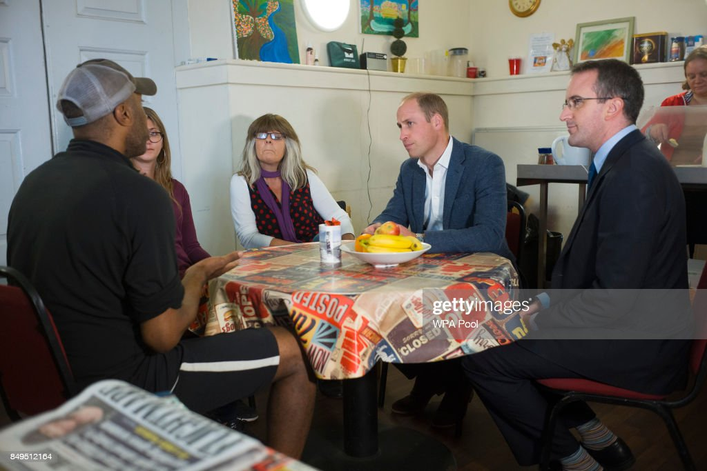 Prince William, Duke of Cambridge speaks with people in the drop in cafe which is geared toward helping the homeless during a visit to the Spitalfields Crypt Trust in St Leonard's Church, Shoreditch on September 19, 2017 in London, England. The trust aims to provide a holistic recovery service for those dealing with complex drug and alcohol addictions.