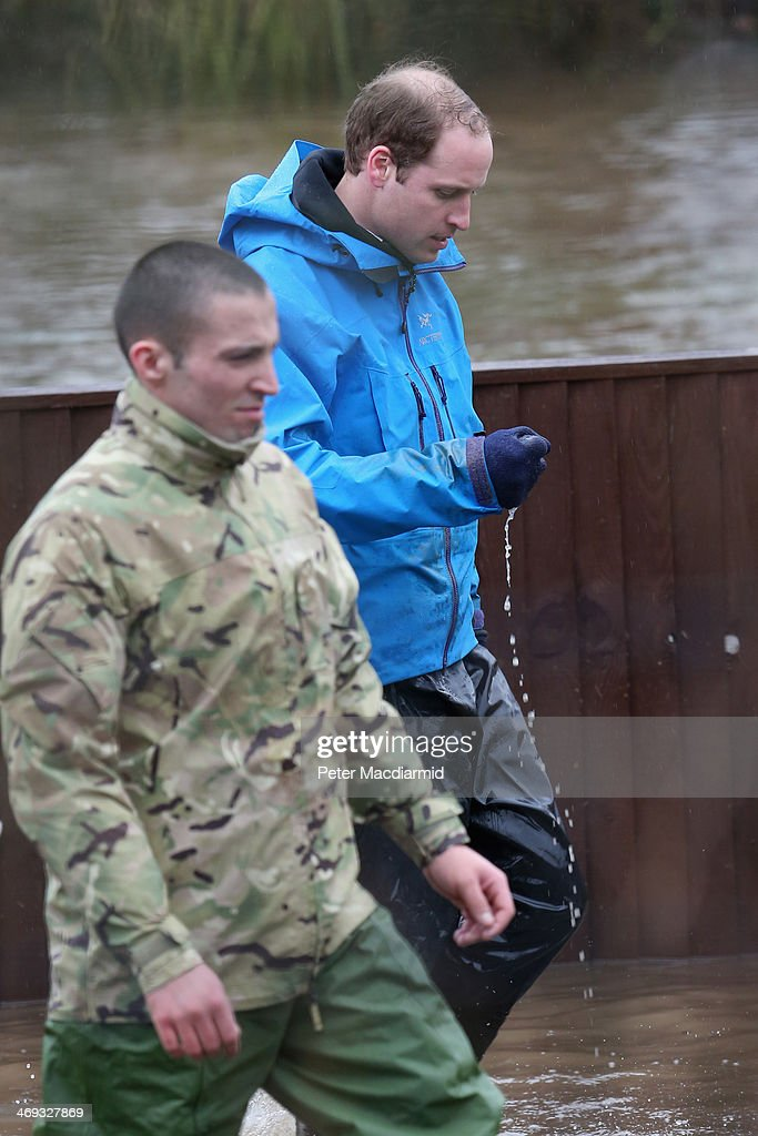 <a gi-track='captionPersonalityLinkClicked' href=/galleries/search?phrase=Prince+William&family=editorial&specificpeople=178205 ng-click='$event.stopPropagation()'>Prince William</a>, Duke of Cambridge squeezes water out of his gloves after helping with flood defences around a school on February 14, 2014 in Datchet, United Kingdom. Flood water has remained high in some areas and high winds are causing disruption to other parts of the UK with the Met Office issuing a red weather warning.