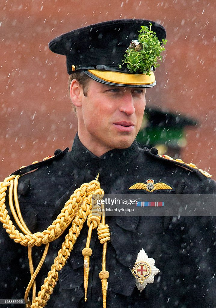 Prince William, Duke of Cambridge (in his role as Colonel of the Regiment) stands in the rain during the St Patrick's Day Parade at Mons Barracks on March 17, 2013 in Aldershot, England.