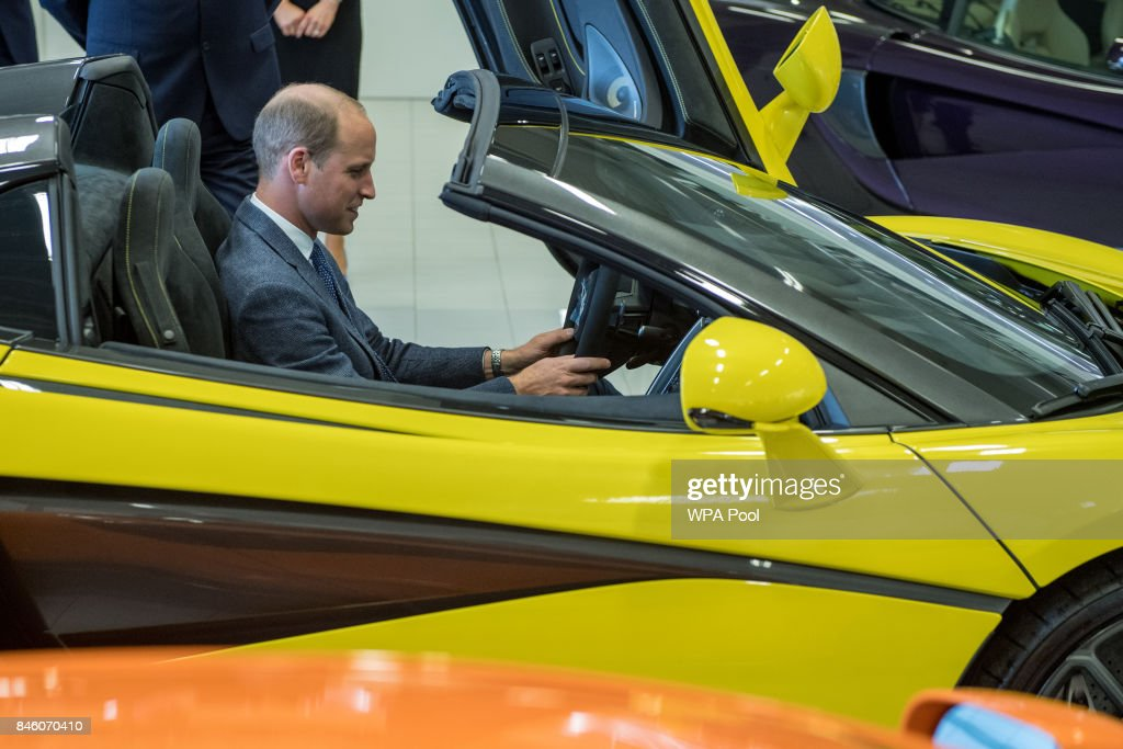 Prince William, Duke of Cambridge starts the engine of a finished McLaren on the factory floor during a visit to McLaren Automotive at McLaren Technology Centre on September 12, 2017 in Woking, England.