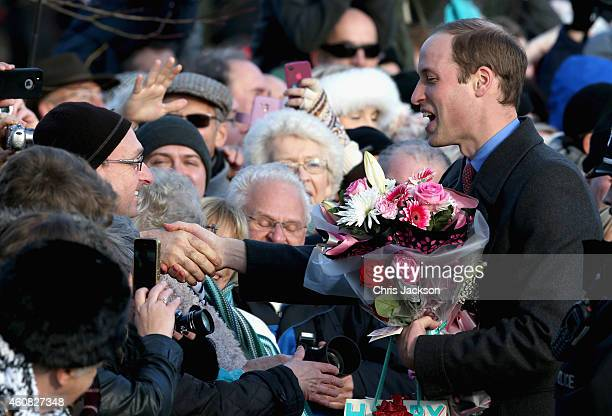 Prince William Duke of Cambridge stops to chat to members of the public as he leaves the Christmas Day Service at Sandringham Church on December 25...