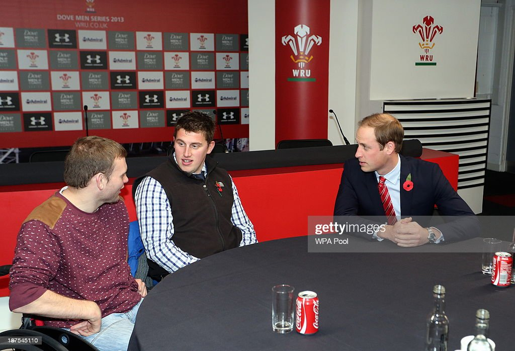 Prince William, Duke of Cambridge t(R) alks with injured WRU players in the Ray Gravell Room coach during the Autumn International between Wales and South Africa at the Millennium Stadium on November 9, 2013 in Cardiff, Wales.