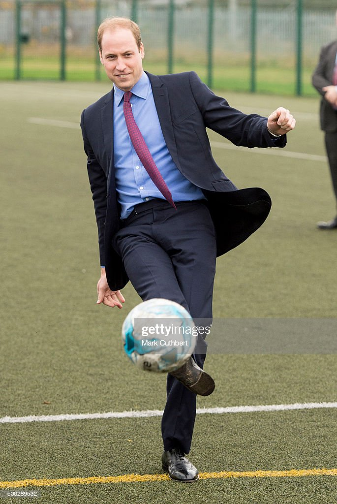 Prince William, Duke of Cambridge takes a penalty kick during a visit to The Football for Peace initiative at Saltley Academy on December 7, 2015 in Birmingham, England.