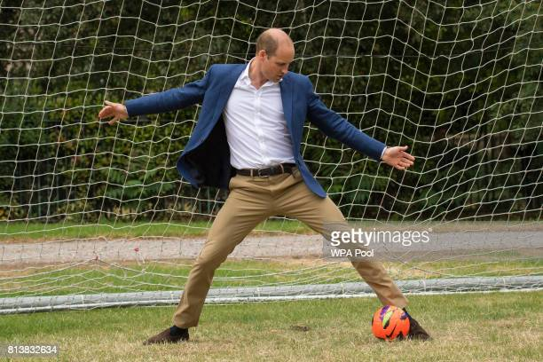 Prince William Duke of Cambridge takes his turn in goal during a kickabout with the Lionesses and local girls team from the Wildcats Girl' Football...
