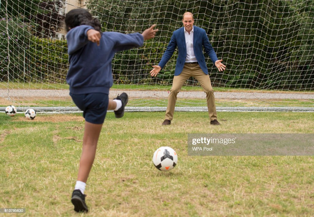 Prince William, Duke of Cambridge takes his turn in goal up against a member of the Wildcats Girl' Football programme during a kick-about with the Lionesses and local girls team from the Wildcats Girl' Football programme on July 13, 2017 in London, England.