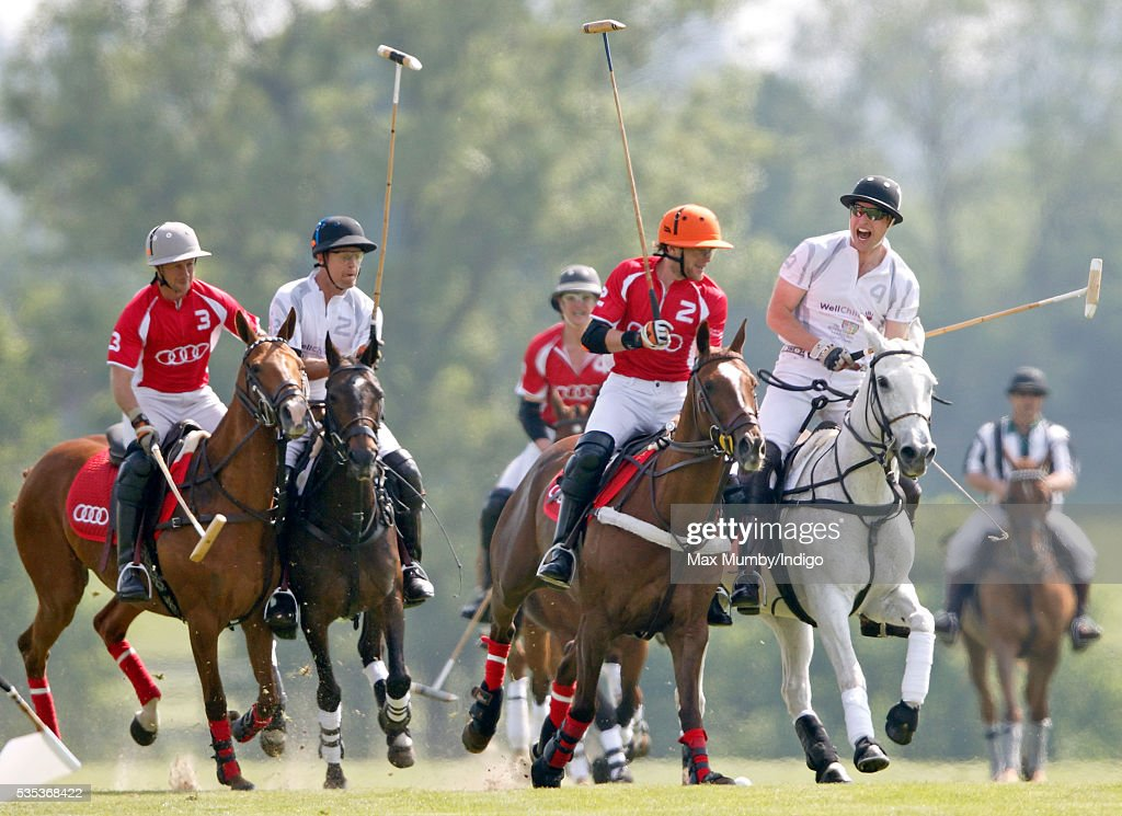 Prince William, Duke of Cambridge (r) takes part in the Audi Polo Challenge at Coworth Park Polo Club on May 29, 2016 in Ascot, England.